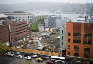 "Construction crews work on building a new underground research laboratory for mice, rat and monkey research below the Portage Bay Vista greenspace in between Foege Hall and Hitchcock Hall at the University of Washington on Thursday, April 23, 2015. The facility is being built underground because the university is running out of space on campus and because the site is considered a ""view corridor"" to Portage Bay."